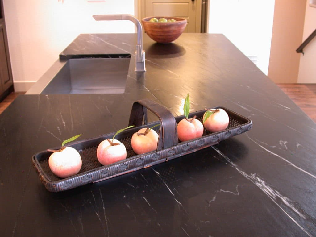 Island countertop crafted of soapstone from Dorado Soapstone.