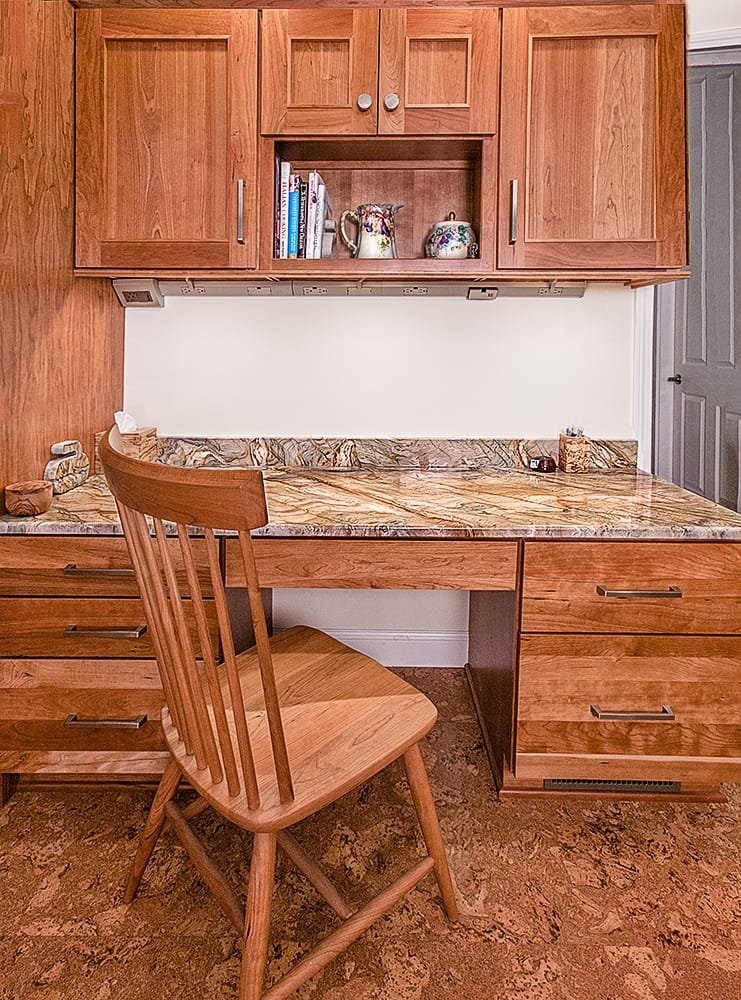 Natural stone works well as built-ins and furniture features in a kitchen. This pocket office in the kitchen has a quartzite desk top from Ripano Stoneworks. Photo credit: Ripano Stoneworks