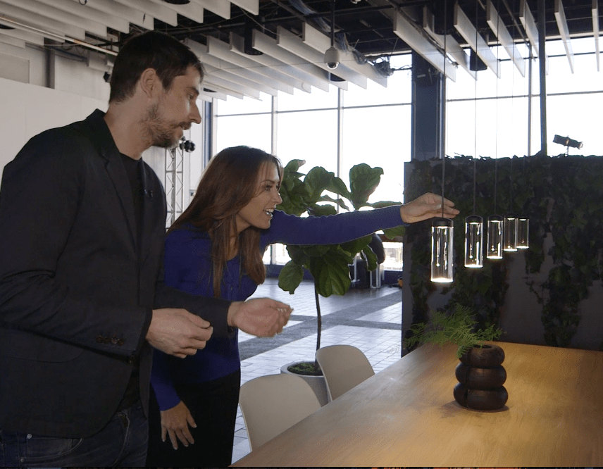 The Design Tourist host Karen LeBlanc and Industrial and Product Designer Todd Bracher check out his Vessel Lamp on view at The Architectural Digest Design Show as part of DIFFA's Dining by Design. Photo Credit: The Design Tourist