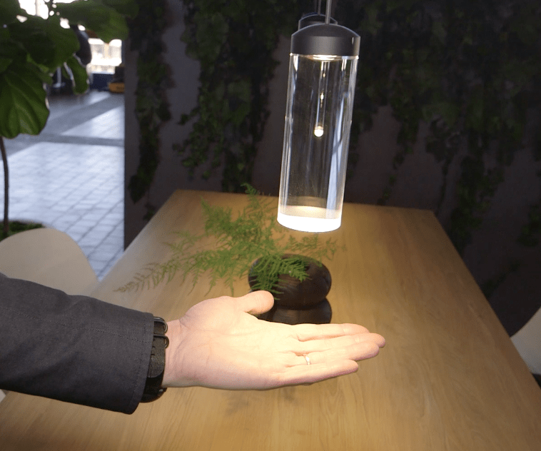The Vessel Lamp designed by Todd Bracher for Humanscale. Todd demonstrates how the LED light source is concealed above a high-quality quartz cylinder. Light is refracted downward through a finely tuned, solid body and appears as though it is emanating from an unseen origin. Photo Credit: The Design Tourist.
