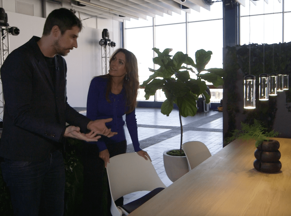 The Design Tourist host, Karen LeBlanc and Industrial and Product Designer Todd Bracher, check out his Trea multipurpose chair, which mimics the instinctive recline of the human body without resorting to manual controls. Photo Credit: The Design Tourist