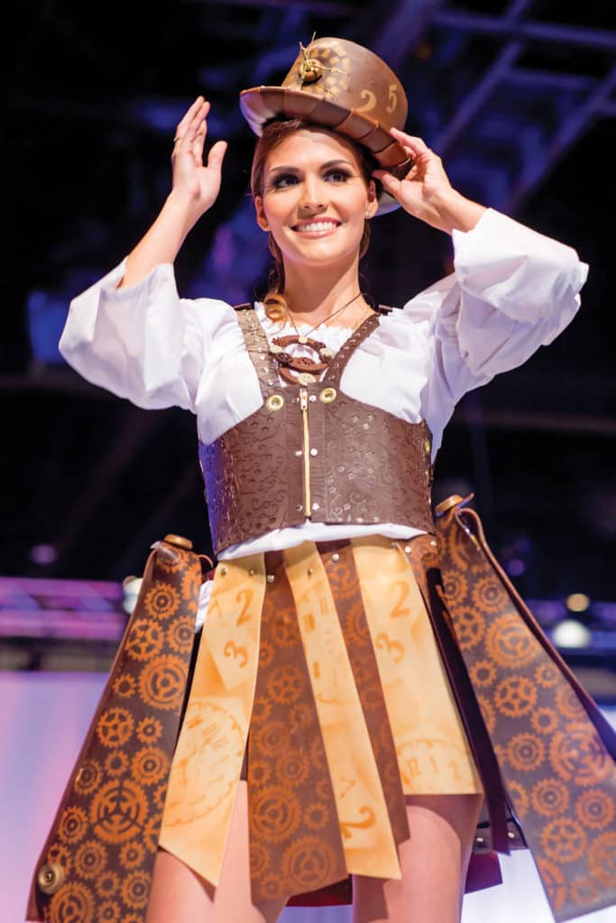 Model wearing a Steampunk outfit crafted of chocolate struts the catwalk for The Sugar Art Fashion Show. photo credit: The Americas Cake Fair