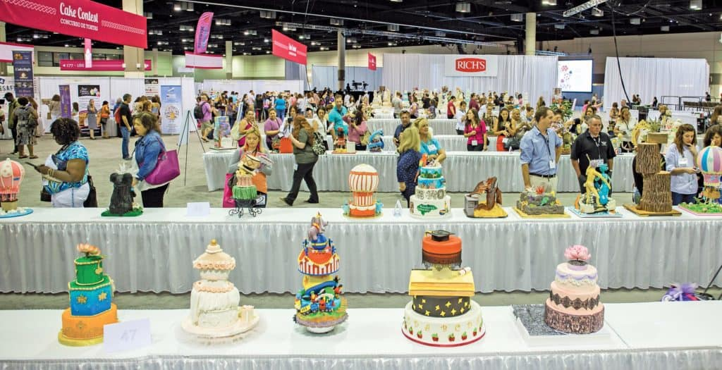 An exhibit hall overflowing with products and services, including some items for cash and carry.