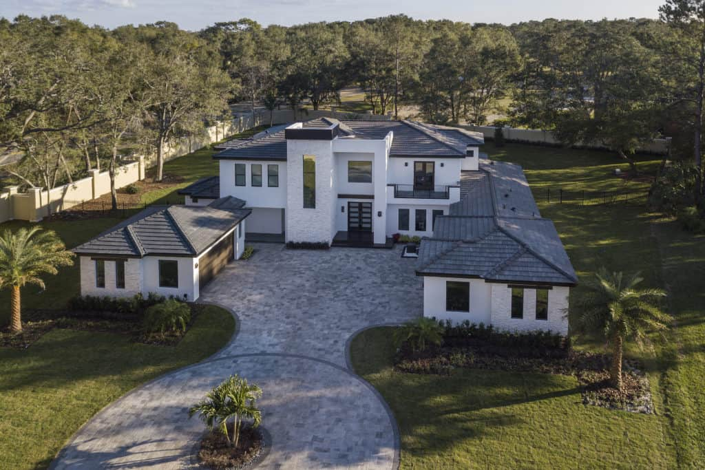 An aerial view of The Design Tourist's personal residence, a Florida Modern home. Notice the subtle pitches in the roofline that are designed to appear planar from the facade and ground level. The home was designed and built by Orlando Custom Home Builder Jorge Ulibarri www.ImYourBuilder.com