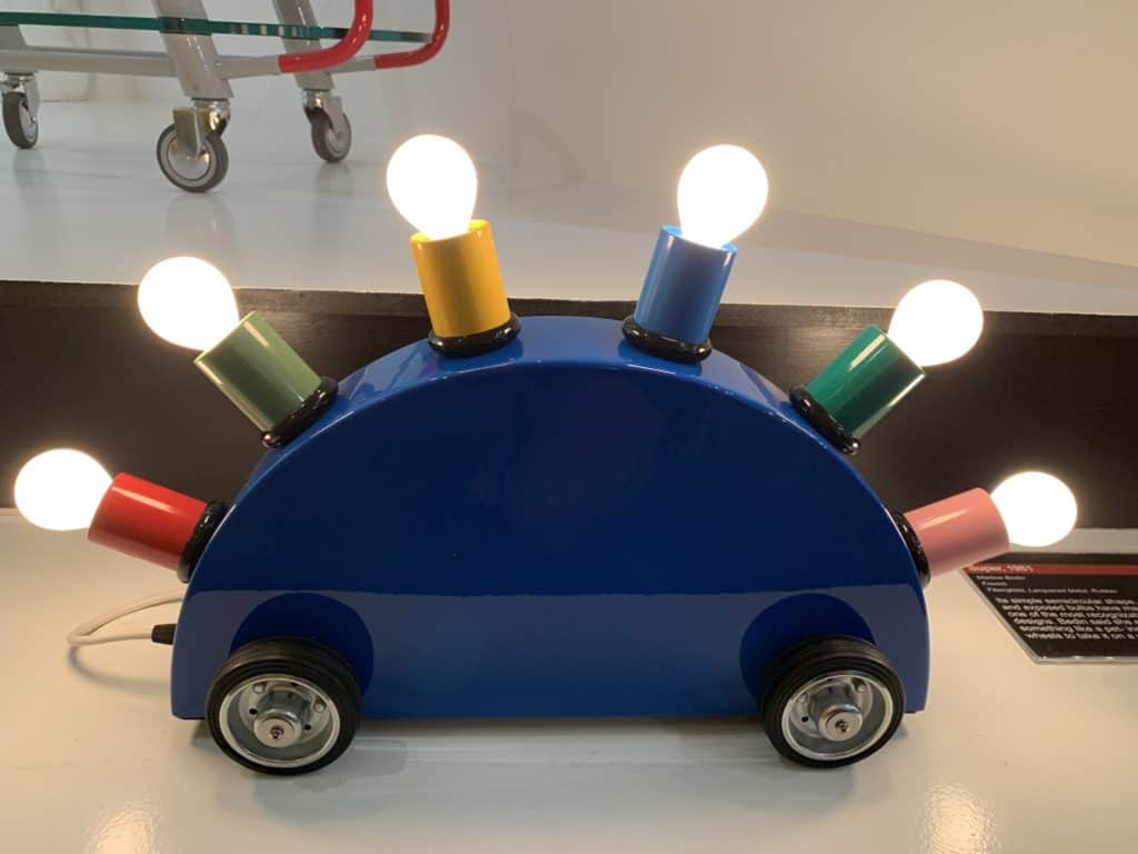 Super, 1981 by Martine Bedin. This light is made of fiberglass, lacquered metal, and rubber. It is one of the most recognizable of Memphis Designs. Designer Martine Bedin envisioned it as a pet on wheels. Photo credit: The Design Tourist