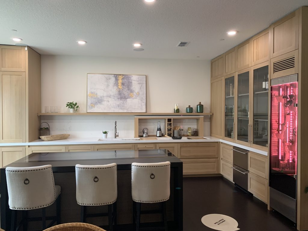 Wellness Kitchen in Whit features a GE Innovative Cooktop embedded in the kitchen island that lets you cook and connect in one intelligent surface. Photo Credit: The Design Tourist