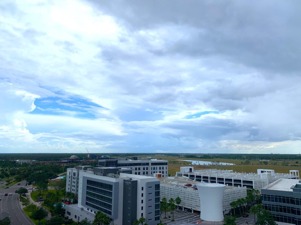 Bird's eye view of Lake Nona overlooking the Beacon Tower and Code Wall Parking garage taken from the rooftop of one of the newest multi-family housing developments, Pixon located in Lake Nona Town Center.