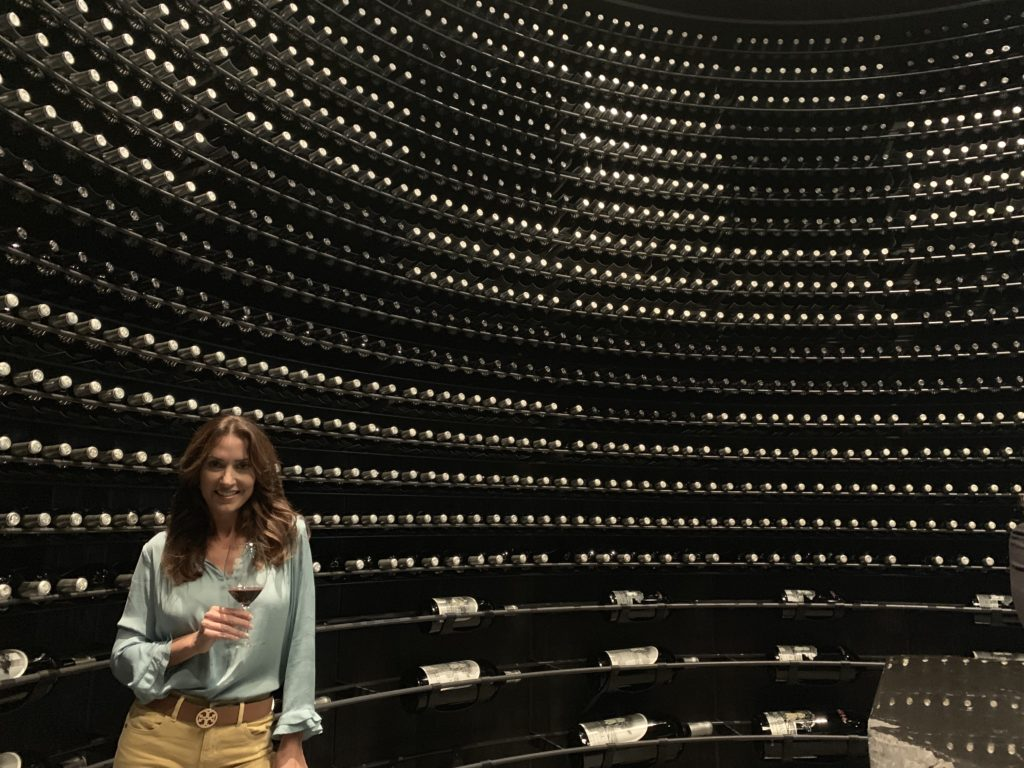 Karen LeBlanc, aka The Design Tourist, in the Silver Oak Wine Library, a circular room lined with bottles of Silver Oak in various vintages.
