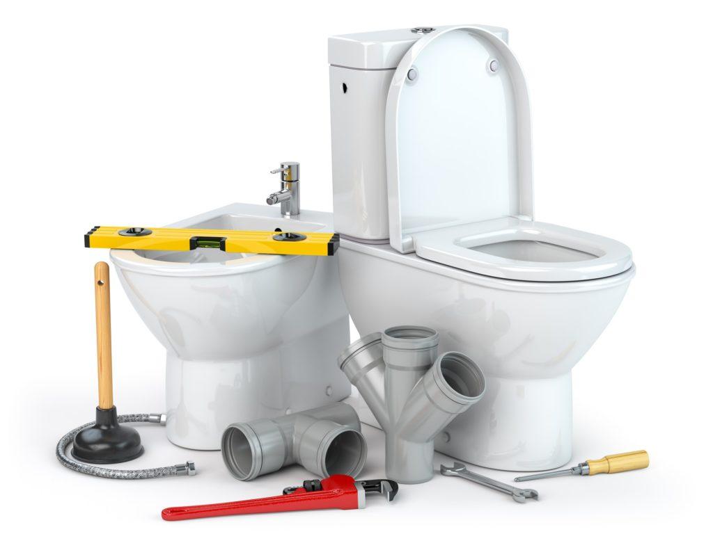 Plumbing repair service. Bowl and bidet with plumbing tools for