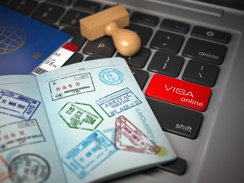 Visa online application concept. Open passport with visa stamps