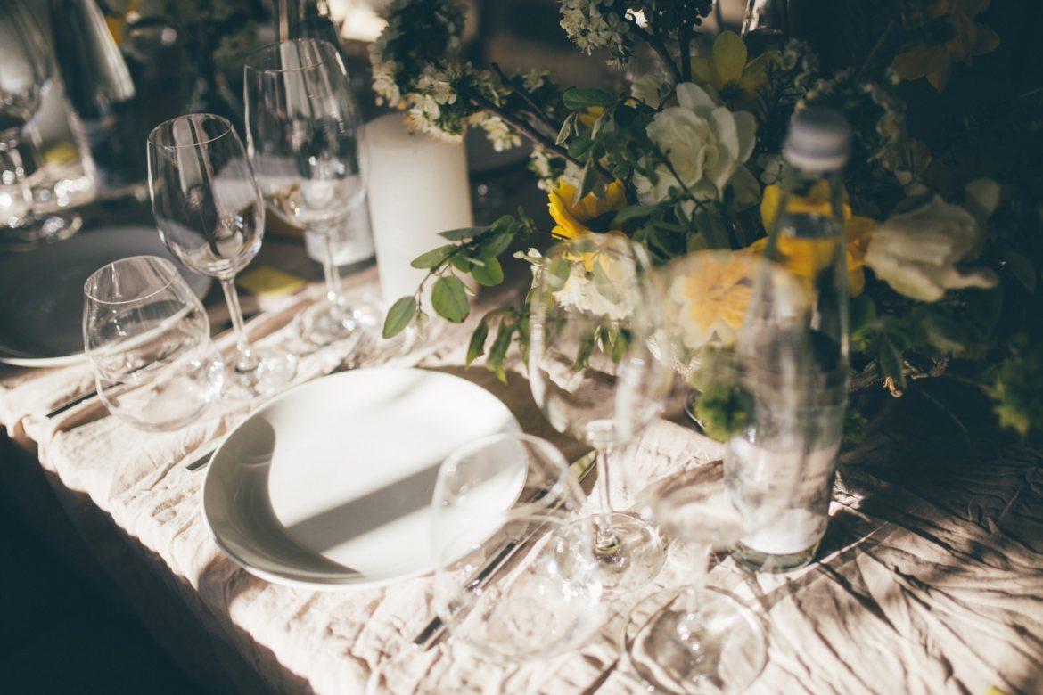 Beautiful table set for some festive event, party or wedding reception on the sunset