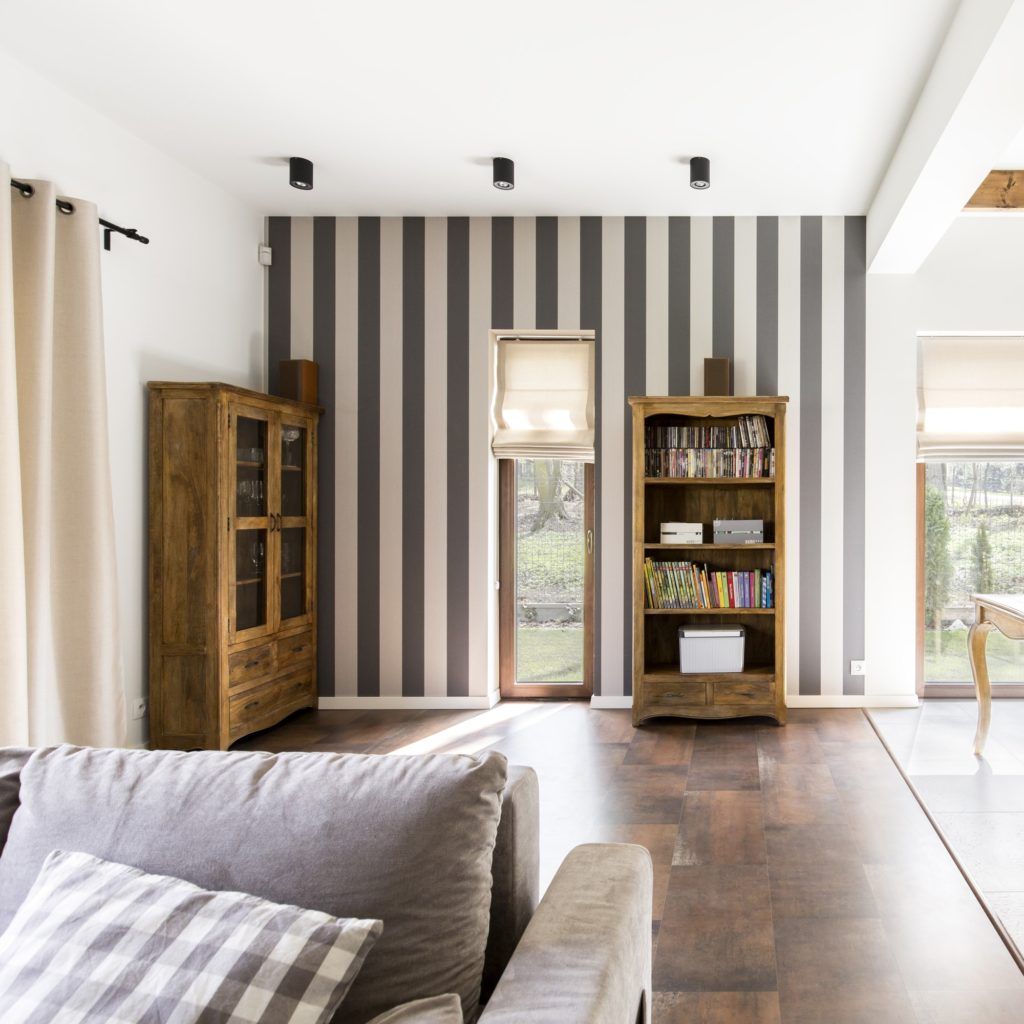 Stylish interior with striped wallpaper
