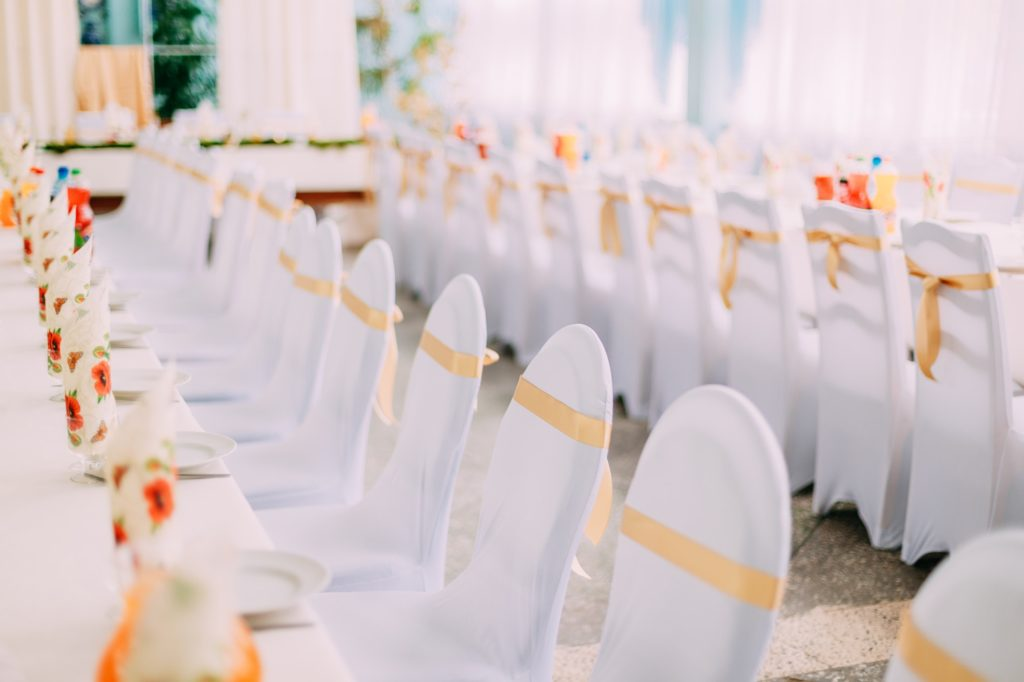 Decorative White Mantles And Colored Ribbons On Chairs At Festiv