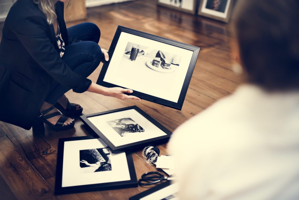 Photo frames on wooden floor