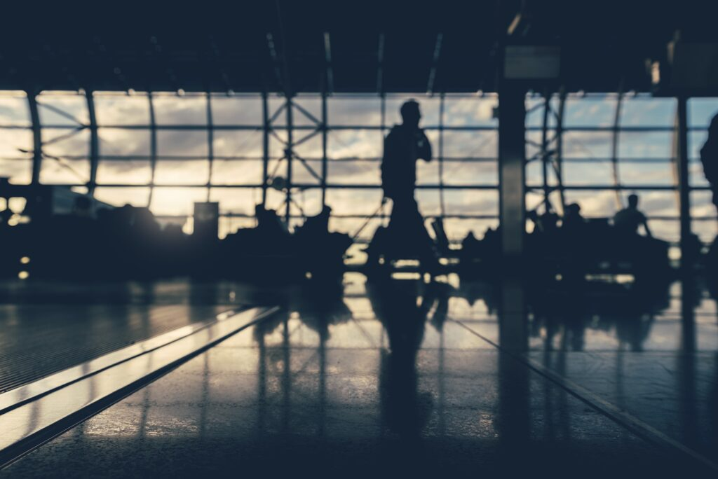 Defocused silhouettes of business people traveling on airport.