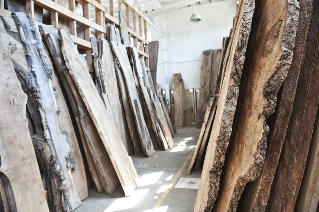 Reclaimed recycled cut slabs of wood in a woodowrking factory.