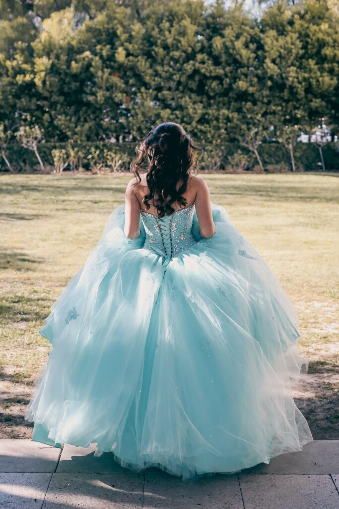 Young woman in a formal dress ready to go to her quinceanera. Sweet 16