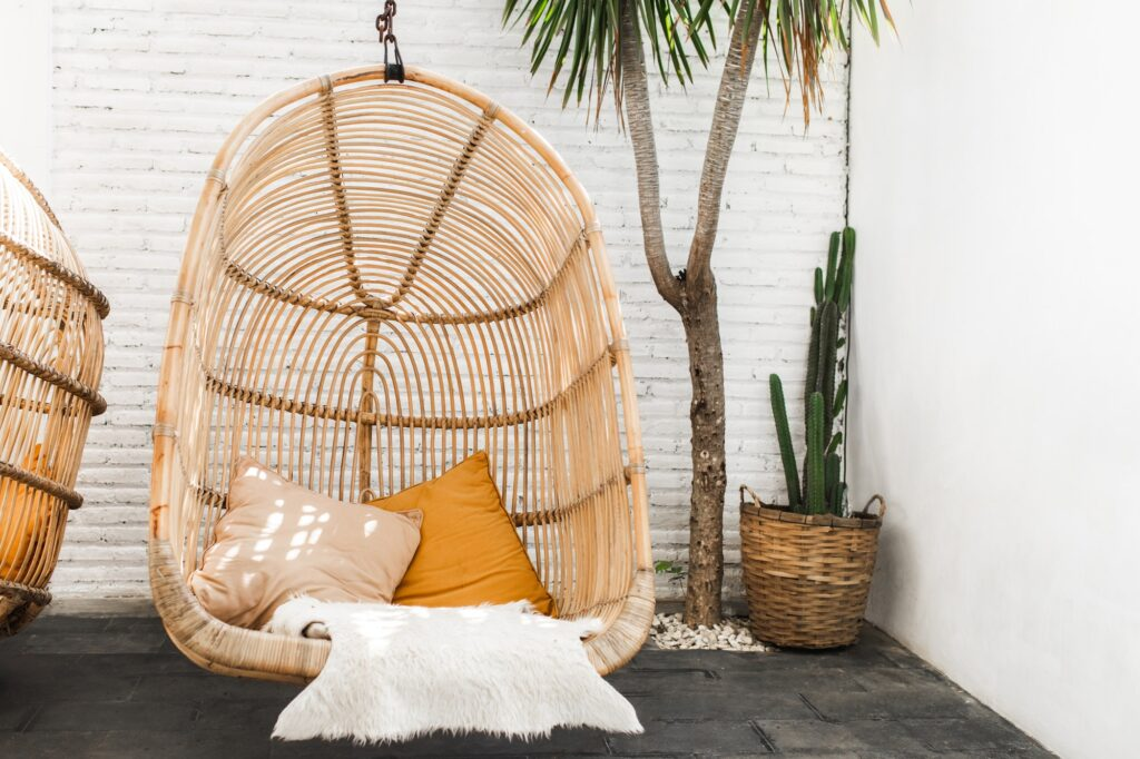 Wicker rattan hanging chair in loft cafe. Eco friendly furniture style and concept